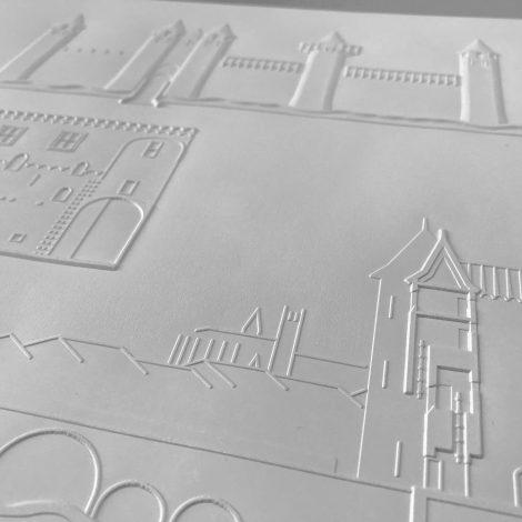 photo détails planche gaufrée représentant les tours de la cité